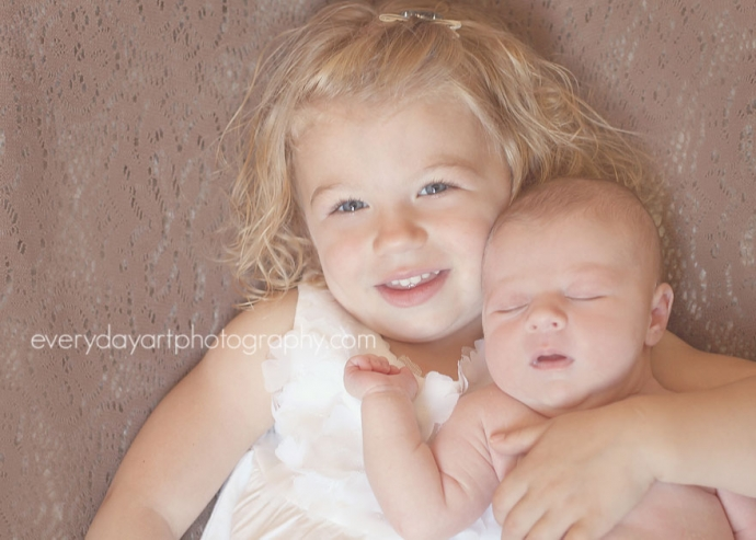 picture of newborn baby and big sister