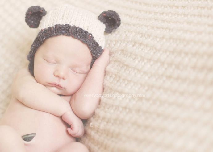 newborn in a bear hat